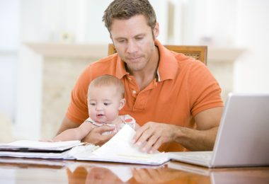 Man working from home with baby