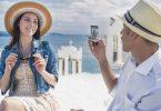 Tourists taking photos, Santorini, Greece